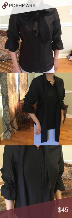 Black romantic blouse Ribbons and buttons makes this blouse romantic looking. Got it dry cleaned but found one stain  when you wear it, the stain can't be seen. Walter Baker Tops Blouses