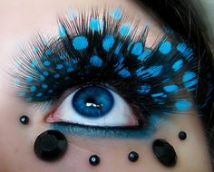 Turquoise spotted feather eyelashes. Black rhinestone accents with turquoise and black liner.