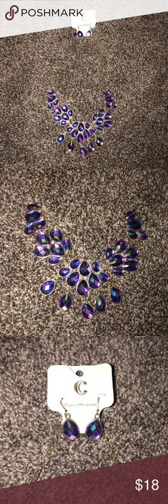 Purple Statement necklace Brand new with tags, never worn. Pretty purple necklace and earring set, originally purchased to wear for homecoming but ended up going with something different . Purchased at charming Charlie's! The chain is gold Charming Charlie Jewelry Necklaces