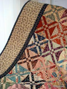 Anita's Arrowhead made from charm squares.