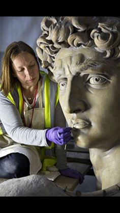 Johanna Puisto, sculpture conservator at the V&A, works on the David statue in the cast court