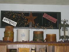 Old shutter repurposed with wood signs I made, rusty star, and pip berries.