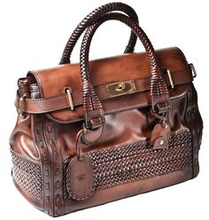 0d9b31174ea gucci - brown leather braided handbag i am usually not one for status bags.