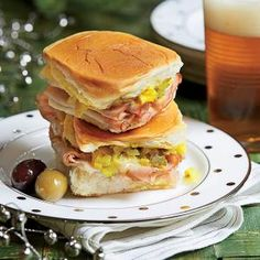 Cuban Sliders Recipe | MyRecipes.com - Southern Living.  A welcome change from the ubiquitous hamburger slider, this mini sandwich has all the flavor of a great Cuban. The key here is to crisp the bread by warming the sandwiches in a hot jelly-roll pan and adding weight on top of the bread.