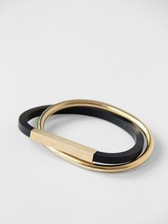 Handmade rubber and goldplated bangle bracelet. Permanently interlocking bangles.