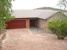 $739000. Property 16. Entrance and 1st double garage of 2