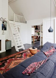 A gorgeous artist's studio apartment in the Netherlands. Spy the loft bed!