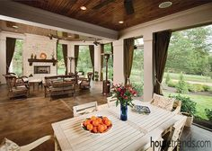 This patio comes with something for every occasion, a dining table for casual meals and a quaint gathering area at the opposite end of the room. Architects: Ken Bowerman and Mary Cassinelli; Builder: Core Resources, Inc.; Landscaping: Botanics