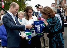 Prince William inspected the sports jersey given to him byBC Governor Christy Clark at the Cridge Centre