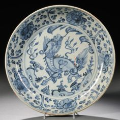 Blue and White Swatow Charger, China, Ming Dynasty, charger with gently curved sides, the central medallion depicting a qilin encircled by a repeating floral motif, the exterior similarly decorated, dia. 12 in.