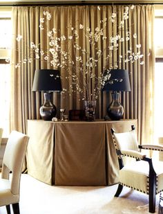 Sumptuous textiles and warm neutrals create a restful, luxurious space (designed by Susan Ferrier)