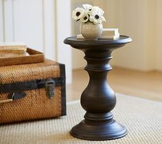 This is great in your space as it would give the impression of a pawn on a chess table while making a traditional design statement. Russel Pedestal Side Table #potterybarn