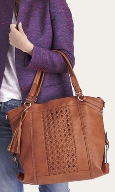 Roomy tan tote bag with gold-toned hardware