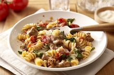 Tomato and Spinach Pasta Toss- very easy sausage pasta recipe.  Delicious.  Try Jennie-O italian turkey sausage to make it healthier without sacrificing taste.