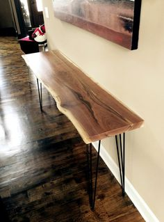Looking for a truly unique console table? Check out our Black Walnut Console Table!  This particular table has been sold, but we would love to make you a similar one!  Your table may vary in price to this one depending the exact specifications youre looking for.  Give us a call or shoot us an email if youd like to discuss making a custom table!  913.735.0123 KCCustomHardwoods@gmail.com www.KCCustomHardwoods.com  Every piece of furniture we make is 100% hand-made out of reclaimed wood from…