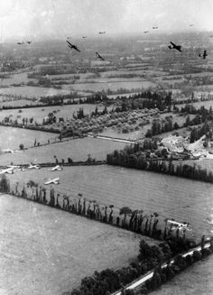 The fields of Northern France are littered with gliders as the Douglas C 47s that towed them there leave the area.