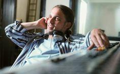 Man at control panel in recording studio