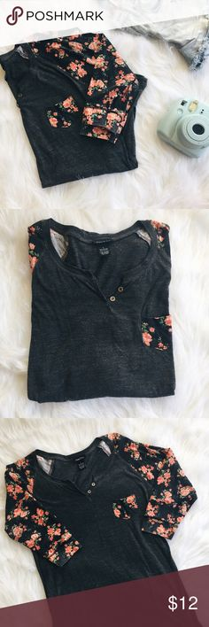 "Rue 21 Heather Gray & Floral Sleeve Baseball Tee ▪️Product Description▪️ ▫️Cozy and cute baseball tee with a girly rose print on sleeves and front pocket ▫️2 little buttons on the neck for decoration ▫️3/4 sleeve ▫️Heather gray and somewhat sheer fabric   ▪️Fit: Classic t-shirt style, clingy fabric so most likely suited to a medium, long- tunic length that bunches up really cute  ▪️Condition: Gently used & some minor pilling due to wash  ▪️Measurements: Approx/Laying Flat  ▫️Chest- 17""…"