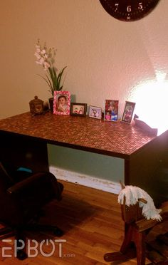 EPBOT: Penny lined desk top WITHOUT the epoxy resin topper.. U can leave it as is or even purchase a piece of pre cut tempered glass for the smooth desk top finish. Wonderful way to use all those pennies nobody likes these days!