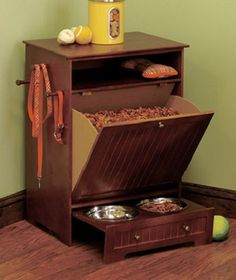 "A handsome way to store your best friend's favorite food. When it's mealtime, pull out the lower shelf,has 2 stainless steel pet bowls. organize toys and brushes. Hold collars and leashes. Bowls, 7-1/2"" dia. x 2"". Cabinet, 26-5/9"" x 19"" x 13-1/2"". Bowls are dishwasher safe. Assembly required; assembly hardware included. Feeding station hides away when not in use. Organize dry food, bowls, toys, leashes and more all in one place. Details: Removable bowls, 26-5/9"" x 19"" x 13-1/2""  $79.99"