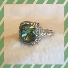 NWT. Simply Beautiful Ring Medium shade of green with accent clear hems around it and 4 down each side. Stunning. Brand New!!! Jewelry Rings