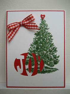 Or at least that's what I see when I look at this card.  Maybe it's the red and white ribbon or the heart shaped tree topper that projects a...