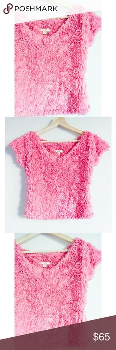 "Hollister Cute Pink Fluffy Faux Fur  Sweater Shirt Women's size small. Excellent brand new condition!  100% Cotton Fabric Short sleeve, crop top style sweater.   Pink faux fur, fluffy look. Measurements: Chest: 16""  Body length: 13.5"" Sleeve length: 6"" Sleeve opening: 5"" Hollister Sweaters Crew & Scoop Necks"
