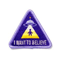 """The truth is out there - Embroidered patch with merrowed edge - Iron-on adhesive backing - Measures 2.5"""" tall x 2.5"""" wide"""