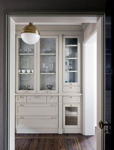 Love the shaker cabinet and the location/style of the pulls. Courtney Hill Interiors - Butler's pantry, glass fronted cabinet with wallpapered cabinet interior, gray kitchen cabinets with brass hardware, brass and opalglass Hicks pendant, Glass Front Cabinets, Grey Cabinets, Kitchen Cabinets, Kitchen Pantry, New Kitchen, Kitchen Pass, Swedish Kitchen, Kitchen White, Home Interior