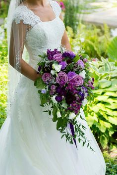 Cascading bridal bouquet in purples