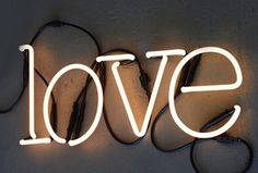 """This neon """"love"""" sign is an eye catching piece of art."""