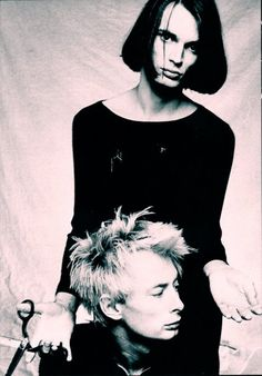 This photo of Jonny Greenwood and Thom Yorke hung up in my room ALL of middle school and high school.