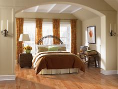 Elegant master bedroom design with plenty of natural light and luxurious hardwood floors.