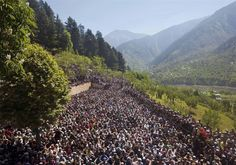 Kashmiri Muslims pray during special prayers at a forest shrine of Miyan Peer.