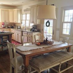 Farmhouse kitchen table and mismatched chairs with bench eclecticallyvintage.com