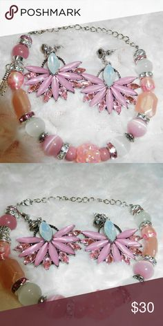 Cotton Candy Blossoms Bracelet and Earring Set Pink and white cat's eye beads, rose and clear crystal jewels, silver feather charm, Tibetan bead spacers, pink shamballa bead, rose beads make up this candy bracelet. 26 cm length Handmade Jewelry Bracelets