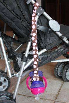 Favorite  Like this item?    Add it to your favorites to revisit it later.  Bottle Tether, Toy Tether, Sippy Strap with Suction Cup-Pink Polka Dots