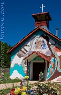 A classic New Mexican church covered with murals.