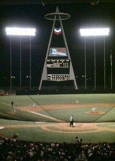 """""""The original """"Big A"""" scoreboard at Anaheim Stadium (now Angel Stadium) before the ballpark was enclosed and the scoreboard was moved to the parking lot. Baseball Scoreboard, Baseball Park, Baseball Pitching, Sports Baseball, Baseball Field, Baseball Stuff, Baseball Cleats, Baseball Buckets, Baseball Pictures"""