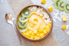 This Mango Pineapple Smoothie Bowl brings the tropics to your breakfast bowl! Customize the toppings on this healthy smoothie bowl for your ideal breakfast.