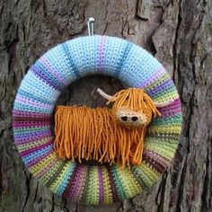 I took the sheep out of the #wreath I made with the colours of #attic24 #moorlandcal and put in a #woollybully instead! Pattern available on my blog #highlandcoo #highlandcow #crochetersofinstagram #iambranchingout