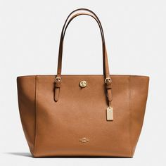 Coach Turnlock Tote ($295) ❤ liked on Polyvore featuring bags, handbags, tote bags, brown, brown tote bag, coach tote, handbags totes, leather handbags and leather tote