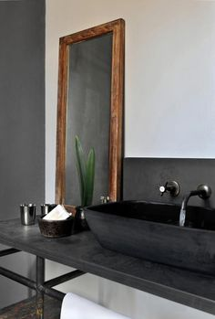 Black stone vessel sinks and vanity in the Satyagraha house; additional view: http://4.bp.blogspot.com/-AvzWGuGyziQ/Tsjs0YZr40I/AAAAAAAAKYY/dxftY_hFEIs/s1600/9798_original_558x823.jpg