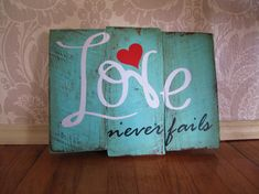 Love Never Fails Reclaimed Distressed Wood Sign Wall Decor on Etsy, $34.00