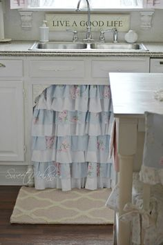 This is exactly the kind of sink my grandmother had. Under the curtain was pure clean ice cold water from the well and an old dipping pan hanging on a nail for a quick drink in the hot summer :O)