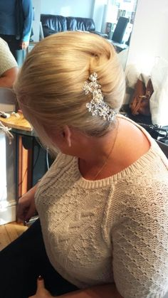 A simple chignon with jewelled clip