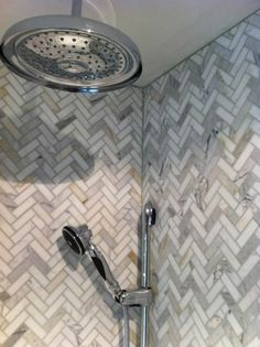 Make a bigger statement with a herringbone pattern for shower tiles | Our Signature Carpet One Floor & Home showroom in Fremont, CA has a vast array of tile. Www.signaturecarpetonefremont.com
