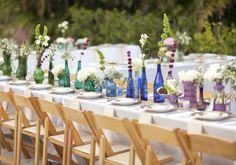 """Tip 3.  Large Reception Tables. By using larger, and therefore fewer, tables you will need fewer centerpieces and tablecloths. Along those lines, I especially love the idea of long, rectangular tables because they create a """"family-style"""", friendly ambiance and therefore encourage conversation."""
