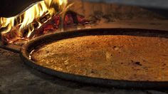 Farinata is made with a mixture of olive oil, chickpea flour, water, and salt and cooked into a thin layer on a hot griddle pan.