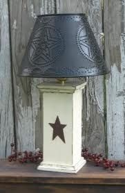 Primitive Lamps for your home decorating needs. Punched tin lamps,country lamps,lighting, and more at affordable prices. Primitive Lamps, Primitive Lighting, Primitive Furniture, Primitive Crafts, Country Primitive, Primitive Bathrooms, Wood Crafts, Primitive Stars, Primitive Bedroom
